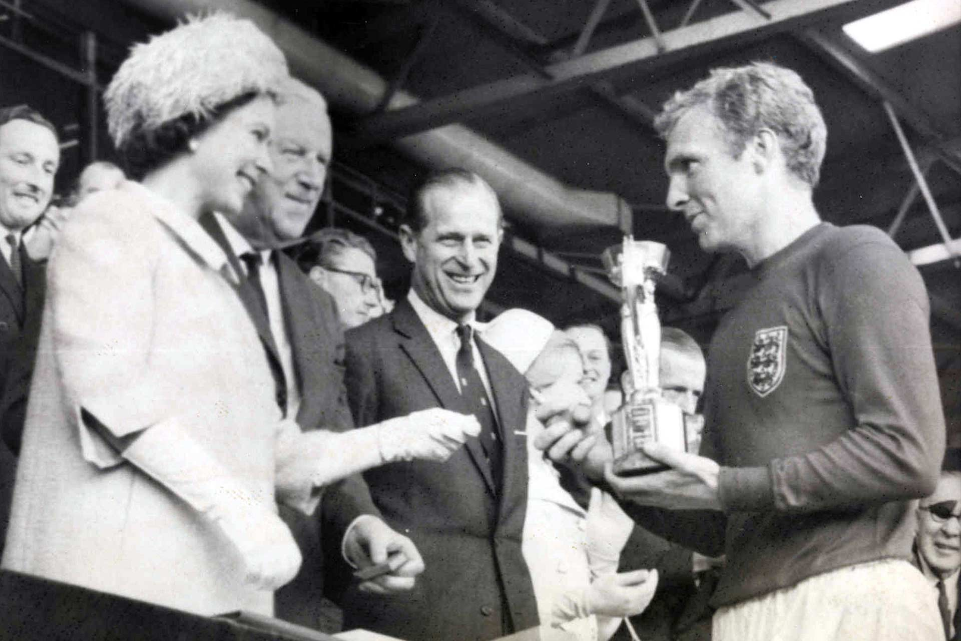 Daily Herald Archive, National Media Museum. The Queen presenting the cup to Bobby Moore. 30 July 1966
