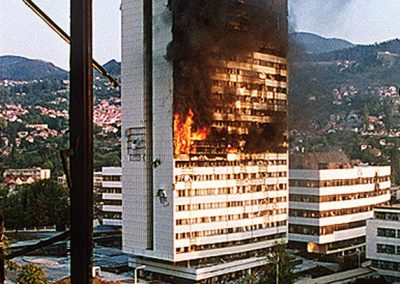 The government building in the centre of Sarajevo burns after being hit by tank fire during the siege in 28 May 1992