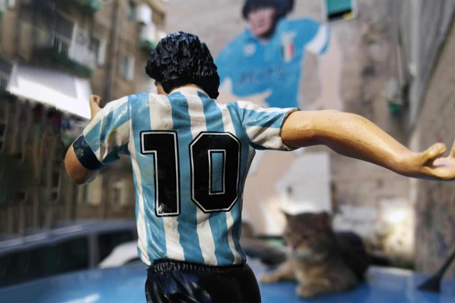 Naples Maradona mural and action-figure